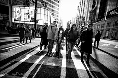 Look Back Boy (The Lazy Photographr) Tags: street city sunset people urban toronto ontario canada blackwhite downtown citylife yongestreet lightshadow dundassquare dundasstreet canon5dmrkiii
