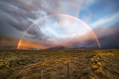 Rainbow Sunrises (Bereno DMD) Tags: morning sunset patagonia sun color southamerica nature colors field rain clouds sunrise fence intense rainbow saturated flat horizon wide vivid wideangle powerful mothernature southernpatagoniaicefields
