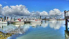 - A ship in harbor is safe, but that's not why (genevieve van doren) Tags: sky reflection water netherlands clouds port boats harbor eau bateaux ciel nuages paysbas pontoon ponton reverberation breskens