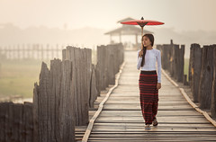 N13_5365 (Bugphai ;-)) Tags: wood travel bridge red portrait people woman girl beautiful face fashion female rural umbrella sunrise asian thailand happy gold golden wooden costume nice asia warm pretty outdoor burma buddhist traditional rustic silk culture bein lifestyle vietnam fabric u myanmar tradition cloth charming elegant laos burmese greeting mandalay polite bagan unidentified accessory aec