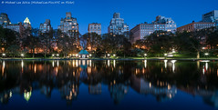 Fifth Avenue Reflection (DSC04293-Pano-Edit) (Michael.Lee.Pics.NYC) Tags: panorama newyork reflection architecture night twilight cityscape centralpark bluehour fifthavenue a7rm2 zeissloxia21mmf28 modelsailboatbasin