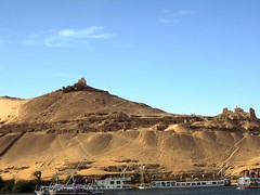 Egypt (Aswan) Hillside is dotted with the Tombs of the Nobles (ustung) Tags: rock landscape desert outdoor hill tomb egypt hillside aswan noble felucca nileriver
