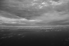 cloudy (felipeepu) Tags: sea sky white black clouds plane flight