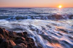 Panta Rei (Luca Romano) Tags: longexposure travel sunset sea beach landscape flow rocks mare loneliness shine outdoor coastline rocce flows viaggiare seasunset seasunclouds shiningsunset sunlandscape
