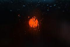 Raining... (CutenessInTheWeird) Tags: nightphotography light orange window glass rain night streetlight bokeh raindrops raining bokehballs