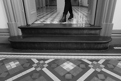 Black boots out (alideniese) Tags: urban blackandwhite bw monochrome legs boots steps sydney streetphotography australia doorway tiles flooring qvb tessellated