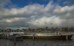 Rain clouds over Zaandijk (farflungistan) Tags: winter holland nederland stormy zaanseschans daytrip rainclouds zaandam tourboat northholland