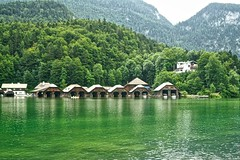 Boat houses at the Knigssee in Bavaria, Germany (UweBKK ( 77 on )) Tags: trees houses lake mountains alps water forest germany bayern deutschland bavaria see boat europa europe minolta 7d konica dynax alpen dslr knigssee