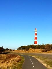 Lighthouse (danielauellendahl) Tags: blue red sky lighthouse white holiday rot beach netherlands dunes leuchtturm weis