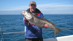 "Paul Thompson with a 14lb Pollack • <a style=""font-size:0.8em;"" href=""http://www.flickr.com/photos/113772263@N05/26377126066/"" target=""_blank"">View on Flickr</a>"