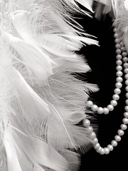 Classic style (Natalya Karavay) Tags: blackandwhite paris classic fashion audreyhepburn feathers style pearls boa chanel fashionable parisienne