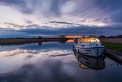 Fairway (CaptainGlasel) Tags: sunset water reflections river reeds boat nationalpark norfolk rivers waterways broads norfolkbroads stbenetsabbey riverbure broadsnationalpark