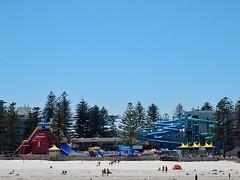 The Shapes of Recreation (mikecogh) Tags: beach sand ferriswheel waterslide umbrellas glenelg thebigwedge