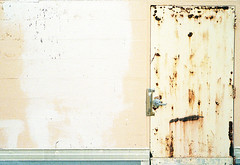 (JoeBenjamin) Tags: door camera blue roof urban brown white color film yellow 35mm concrete fire beige aperture rust paint kodak decay painted over rusty rangefinder doorway negative faded rusted electro blocks gt gsn breeze priority 35 portra derelict 800 locked gs yashica 45mm scars scarred c41 breezeblocks f17 yashinon gtn breezeblock