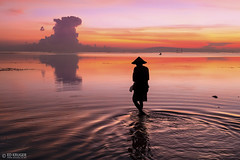 Bali Sunrise (Ed Kruger) Tags: ocean morning travel pink blue sunset red sea summer sky bali sun seascape water yellow clouds sunrise indonesia landscape fishing fisherman asia southeastasia asians january wave sunny copyrights allrightsreserved 2016 travelphotography peopleofasia asiancities edkruger asiancountries cultureofasia photosofasia abaconda qfse kirillkruger rodkruger millakruger