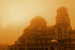 Alexander Nevsky Cathedral in the fog (stranger_bg) Tags: travel roof red sky cloud sun color building art church colors silhouette fog architecture clouds sunrise photo colorful purple cathedral photos sofia outdoor picture bulgaria cielo christianity alexander gsm nevsky храм катедрала българия софия паметник мъгла християнство вяра александър невски туризъм