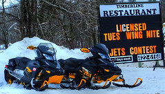 Sleds at The Timberline Restaurant in Richer, Manitoba (ezigarlick) Tags: winter snow canada restaurant cafe diner manitoba snowmobiles sleds skidoo richer timberlinerestaurant