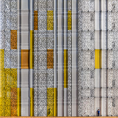 A Place in the Sun (Paul Brouns) Tags: boy urban orange white building art geometric netherlands yellow architecture facade print paul parkinglot pattern geometry circles patterns parking nederland holes geometrical moire hoofddorp brouns paulbrouns straightfacade paulbrounscom