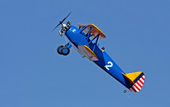 Climbing Into The Blue (jrussell.1916) Tags: blue yellow aircraft airplanes kansas biplane shawneemissionpark remotecontrolaircraft canon400mmf56lusm airplanesinflight