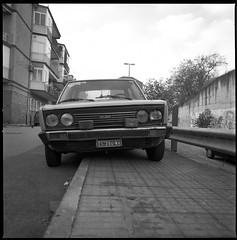(Fiat 131 S Mirafiori) (Robbie McIntosh) Tags: blackandwhite bw 120 6x6 film monochrome car mediumformat square classiccar fuji fiat kodak hc110 hasselblad negative neopan 131 acros dyi pellicola hasselblad500cm mirafiori selfdevelopment mittelformat fujineopanacros moyenformat filmisnotdead medioformato homedevelopment kodakhc110dilb fiat131mirafiori carlzeissdistagon50mmf4ct fiat131smirafiori