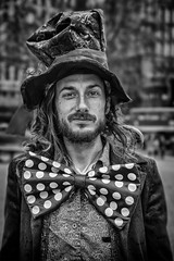 Street Portrait of the Mad Hatter (Daz Smith) Tags: city uk portrait people urban blackandwhite bw man streets male blancoynegro monochrome canon paul blackwhite bath tea candid citylife thecity streetphotography bowtie cycle tophat chai madhatter teaparty canon6d dazsmith bathstreetphotography