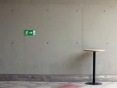A table in the city (Lukinator) Tags: city shadow urban green sign wall circle underground table alone symbol stadt finepix figure fujifilm stick exit grn simple tisch der rund schatten ein circular mauer untergrund zeichen kreis hs20 ausgang alleine simpel strichmnnchen stdtische kreisfrmig