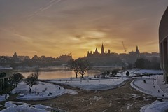 Golden dawn on the hill (beyondhue) Tags: winter sun snow ontario canada tower sunrise river landscape gold dawn cityscape peace quebec sony ottawa hill parliament canadian gatineau hue a6000 beyondhue