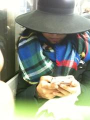 IMG_2050 Two thumbs and a hat (oberondilettante) Tags: bus hat concentration sash smartphone chapeau thumbs autobus elegance parisienne pouces chle pariswoman