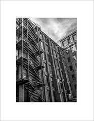 Escape Route (lclower19) Tags: bw white black building mill architecture lawrence massachusetts frame fireescape hdr everett