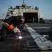 A Sailor welds a bolt aboard USS Fort Worth.