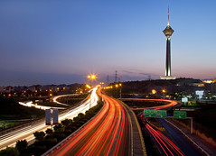 Tehran at night (J.fadi) Tags: city blue light red sky urban tower architecture night speed landscape town high highway cityscape view traffic iran persia landmark panoramic trail tehran milad