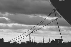 Skyline (Maxi Winter) Tags: sky blackandwhite clouds port harbor ship noiretblanc cloudy crane himmel wolken sunny ciel ropes nuages hafen sonnig kran schiff bremerhaven grue cordes wolkig taue navire nuageux beateau cordage ensoleill seile schwarzweis