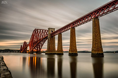 Forth Railway Bridge (nicksimages.com) Tags: ocean road old uk longexposure railroad travel bridge sunset sea reflection monument water architecture night clouds sunrise dawn lights bay scotland site seaside high twilight edinburgh iron crossing cloudy unitedkingdom dusk steel famous transport scottish engineering railway landmark structure historic forth shore transportation infrastructure pillars connection attraction firth queensferry forthrailwaybridge