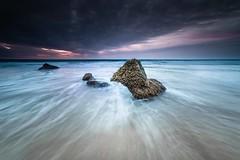 Rocas de Roche 4 (Orion Azul) Tags: ocean sunset sea sky beach rock clouds mar spain long exposure angle sony wide wave playa filter cielo nubes gran angular ocaso hitech roca ola oceano larga crepsculo exposicin filtro samyang