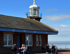 Snacking by the lighthouse at Morecambe (Tony Worrall Foto) Tags: county uk light england people  lighthouse holiday building architecture relax town seaside cafe stream tour open place northwest candid country north picture visit scene location tony resort eat area sat northern update morecambe attraction 2016 holidaytown bythesea seasidetown worrall welovethenorth pictureofthenorth