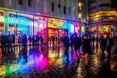 M&M World Reflections (Neal_T) Tags: city uk colour london wet rain reflections fuji norfolk streetphotography norwich leicestersquare fujifilm 12mm londoncity mmworld samyang xt10 samyang12mm