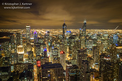 Golden Glow of Chicago (kjkettnerphoto) Tags: lighting city travel vacation sky usa chicago tourism skyline architecture night clouds america skyscraper dark photography evening illinois cityscape escape darkness unitedstates searstower unitedstatesofamerica citylife il nighttime journey northamerica destination tall trumptower johnhancockbuilding bigjohn aonbuilding johnhancockcenter aoncenter destinations standardoilbuilding blurredmotion bigstan amocobuilding traveldestinations colorimage signatureroom buildingexterior highangleview traveldestination downtowndistrict horizontalcomposition willistower