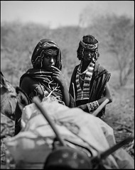 Issa women on their way home (nahlinse) Tags: people film mediumformat iso100 tribes ethiopia nomads issa acros fujineopanacros fujineopanacros100 film:brand=fuji film:iso=100 developer:brand=adox film:name=fujineopanacros100 adoxadonal developer:name=adoxadonal filmdev:recipe=9369
