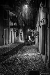 Summer shower (hunblende) Tags: city bw italy rain night shower nightshot oldtown malcesine bestcapturesaoi elitegalleryaoi