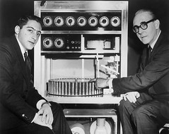 1959 - Film producer Mike Todd Jr (L) with inventor of the 'Smell-O-Vision' machine, Hans Laube. The device injected 30 odors into a movie theater's seats when triggered by the film's soundtrack, and was used for director Jack Cardiff's film, 'The Scent o (Histolines) Tags: history film mike 30 mystery by movie jack for was with films hans machine jr device x retro used seats when timeline inventor l 1200 todd theaters director producer soundtrack scent produced 1959 the 952 laube vinatage injected triggered cardiffs smellovision odors historyporn histolines httpifttt1ub3yh7