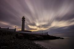 El faro (J Fuentes) Tags: costa lighthouse sol del clouds faro mar movement long exposure flickr save movimiento nubes torrox mlaga largaexposicin