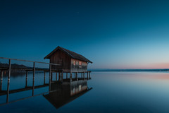 Boathouse (flamelab.de) Tags: longexposure sunset red house lake alps reflection night germany landscape bavaria glow shed scene boathouse ammersee base stegen gnd 845mm