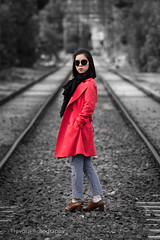 Portrait on the rail tracks, Melbourne (trevorjphotography) Tags: pink portrait woman sunglasses fashion asian vanishingpoint cool bokeh traintracks style attitude raincoat redcoat stylish fashionable prettywoman tramtracks overcoat femaleportrait handsinpockets leadinglines womaninred pinkjacket blackandwhitewithcolour raillines redclothes attractivewoman crossingthetracks tamronsp70300mm canoneos750d standinginthetracks