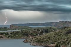 Thunderstorm Strikes Minorca (Markus Trienke) Tags: sea lighthouse water rain weather clouds canon eos coast flash thunderstorm lightning es strom thunder menorca spanien illesbalears 70d puertoluz