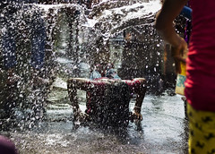 dondi (AanupamM) Tags: travel people india water canon religious 50mm outdoor ritual splash hindu kolkata dondi sprey