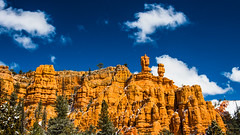 Bryce Canyon 6 (MarcCooper_1950) Tags: trees red sky orange snow colors clouds landscape utah nikon scenery rocks vivid canyon cliffs hills southern boulders hoodoo bryce rainfall hdr formations lightroom mounatins brycecanyonnationalpark geologic d810 marccooper