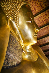Reclining Buddha (tylerkingphotography) Tags: city travel lens thailand photography gold nikon southeastasia photographer outdoor bangkok buddha kingdom buddhism explore backpacking thai kit 1855mm traveling amateur watpho watpo templeoftherecliningbuddha rattanakosinisland phranakhon watphrachetuphonvimolmangklararmrajwaramahaviharn d3100