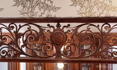 Old brownstone ornate Victorian woodwork (techpro12) Tags: newyork window brooklyn mirror woodwork fireplace interior room parkslope historic partition pediment brownstone mantel baywindows victoiran foyerornate