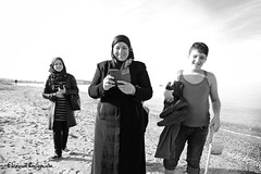 Immigrants from Syria in Crete (Eleanna Kounoupa) Tags: street sea people blackandwhite bw woman beach sand greece crete syria immigrants rethymnon       blackwhitephotos
