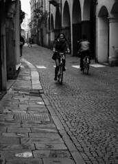 Via Daniele Manin (r_evolution63) Tags: street city urban bw italy woman girl monochrome bicycle grey monocromo blackwhite donna europa europe strada italia grigio ride sony streetphotography streetlife bn bicycles bianconero compact ragazza citt padova bicicletta padua byke veneto biciclette dscw7 pedalare bykes